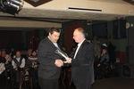 Председатель жюри В. Окунев вручает диплом участника конкурса Андрею Боевец